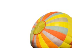 Colorful hot-air balloon laid over the ground on isolated background