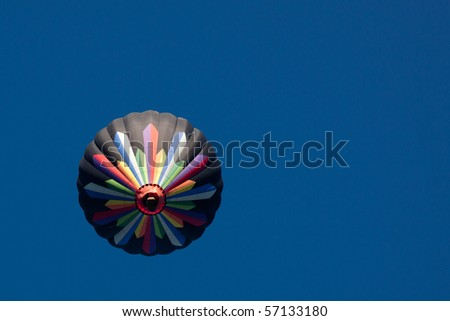 Colorful Hot Air Balloon on Vivid Clear Blue Sky Background