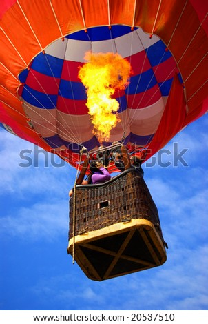 Colorful hot air balloon with bright burning flame