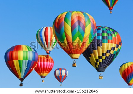 colorful hot air balloons against blue sky