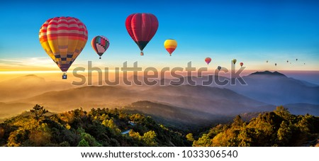 Photo of  Colorful hot air balloons flying over mountain at Dot Inthanon in Chiang Mai, Thailand.