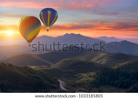 Colorful hot-air balloons flying over the mountain #1033185805
