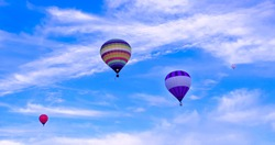 Colorful hot air baloons flying in a summer afternoon