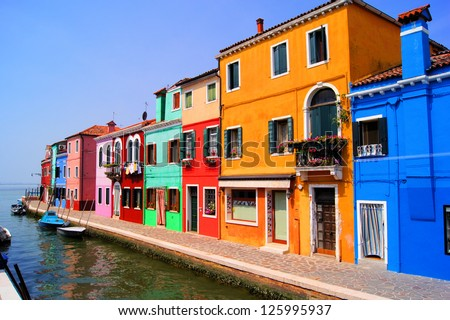 Colorful houses along a canal in Burano near Venice, Italy