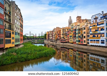 Colorful houses and apartments by the river Onyar in the historic city of Girona, Catalonia, Spain