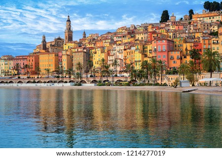 Colorful houses and sand beach in the historical Old Town Menton on french Riviera, France #1214277019
