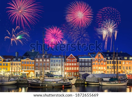 Photo of  Colorful houses at Nyhavn Waterfront (Copenhagen, Denmark) with fireworks during New Year's celebration