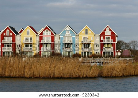 Colorful houses beside a river (swedish style) in red, blue and yellow