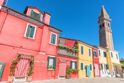 colorful houses by the water canal at Burano Island near venice, Italy