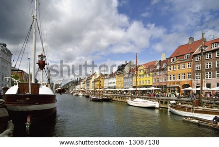 Colorful houses in Copenhagen with a boat
