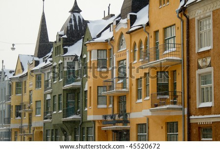 Colorful houses in snowfall