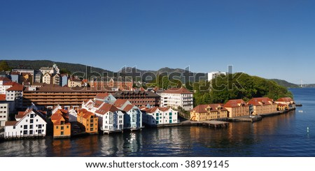 Colorful Houses in the City of Bergen, Norway, at the Fjord Shoreline. Clear blue Sky on a Summer Day.
