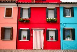 Colorful houses of Burano island, Venice.  Multicolored buildings in sunny day, Venice Province, Veneto Region, Northern Italy. Burano postcard