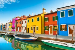 Colorful houses on the canal in Burano island, Venice, Italy. Famous travel destination.