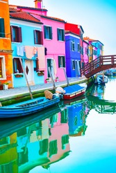 Colorful houses on the canal in Burano island, Venice, Italy. Famous travel destination. Summer landscape