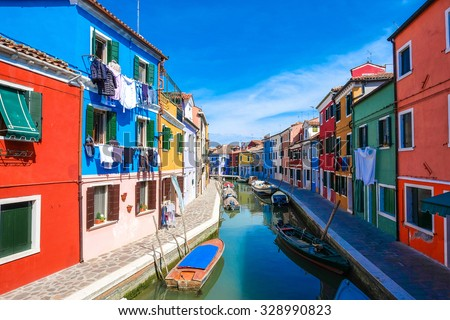 Colorful houses on the famous island Burano, Venice, Italy #328990823