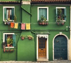 Colorful houses taken on Burano island, Venice, Italy in summer time.
