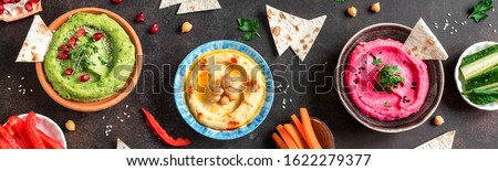 Colorful hummus bowls, healthy vegan dips. Traditional Middle eastern,  green and beetroot hummus, spread.  ストックフォト ©