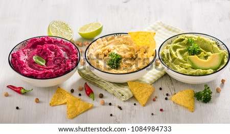 Colorful hummus, different dips, vegan snack, beetroot and avocado hummus, vegetarian eating #1084984733