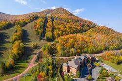 Colorful Hunter Ski Mountain in upstate New York during peak fall foliage.