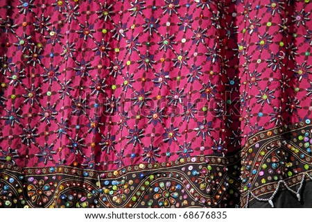 colorful indian fabric with embroidery - stock photo