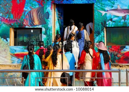 colorful indian women visiting a sea aquarium exhibition in kanyakumari, india