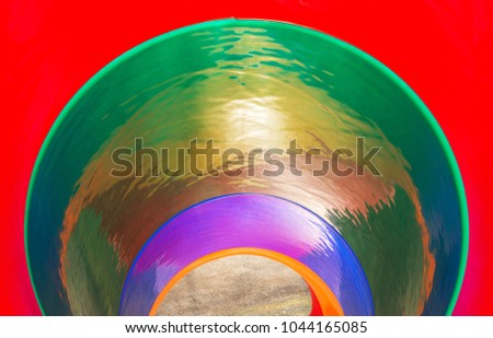 Colorful inside view of a round slide