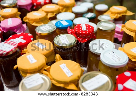 Colorful Jars of Home-made preserves at market stall
