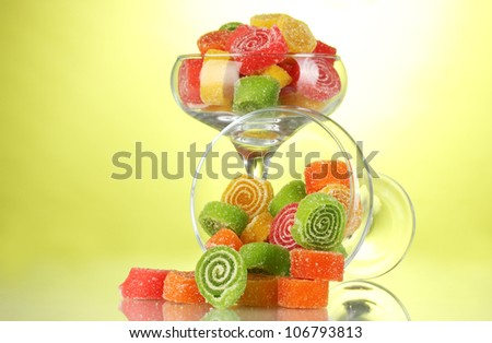 colorful jelly candies in  in cocktail glasses on green background