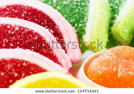 Colorful jelly fruit candies .