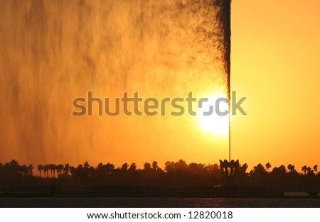 Colorful jet of water at sunset. Jeddah. Saudi Arabia