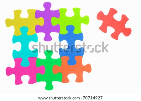 Colorful jigzaw puzzle with the last one unattached, isolated over white background