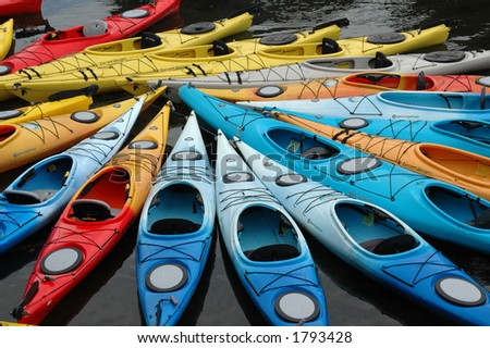 Colorful kayaks clustered together