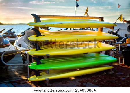 Colorful kayaks near the lake. Water sport equipment rent.