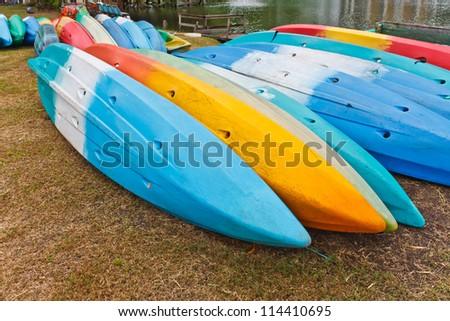 Colorful kayaks on side of the lake