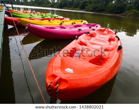 Colorful kayaks on the river