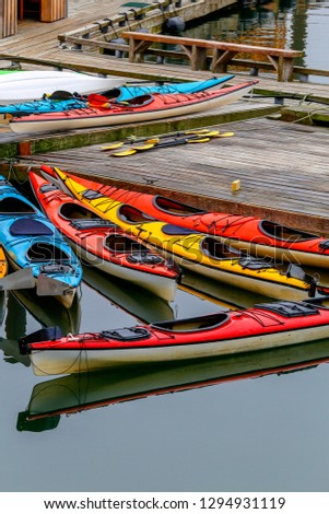 colorful kayaks standing on the pier with calm waters on Ketchikan, Alaska