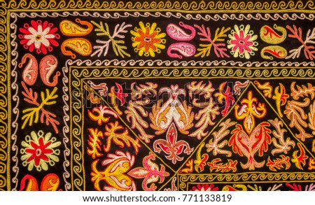 Colorful Kazakh embroidery with floral ornament