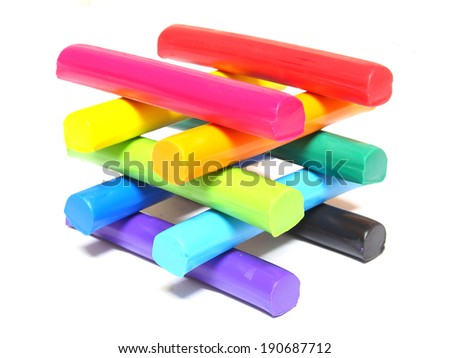 Colorful kid's plasticine on white background