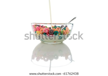 colorful kids breakfast cereal loops with a spoon in fresh cows milk or could be almond milk or even soy milk. isolated on white