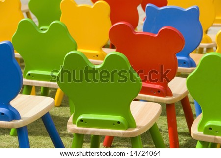 Colorful kids chairs in a playground