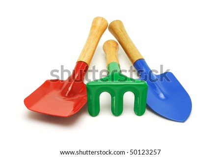 Colorful kids garden tools on white background