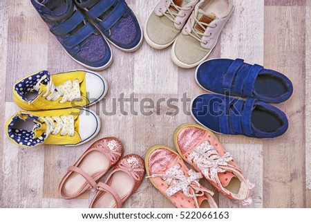 Colorful kids shoes on floor #522066163