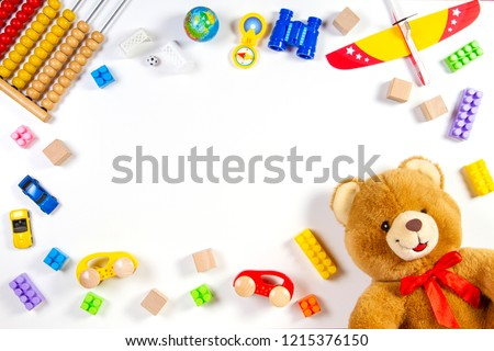 Colorful kids toys frame on white background. Top view. Flat lay.