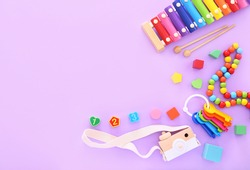 Colorful kids toys on purple background. Top view, flat lay.