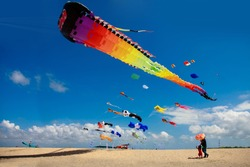 colorful kite festival with background blue sky taken from sanur bali indonesia