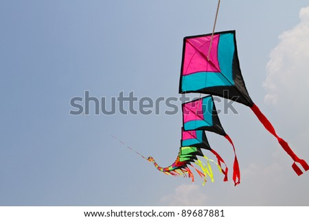 Colorful kites on blue sky