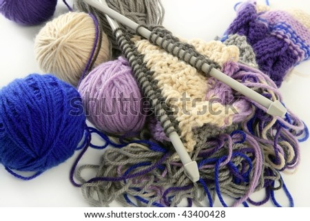 colorful knitting tools with wool thread balls