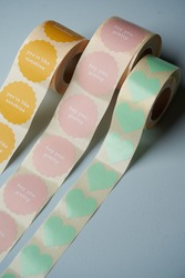 Colorful label rolls on blue background. Stickers rolls for gift decoration