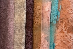 Colorful lace fabrics are neatly lined up to be sold in mark